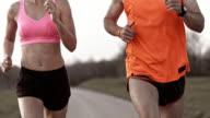 SLO MO TS Man and woman running