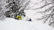 SLO MO Man and woman skiing in powder snow