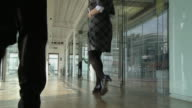 LA WS Man and woman sneaking into empty office together/ London, England