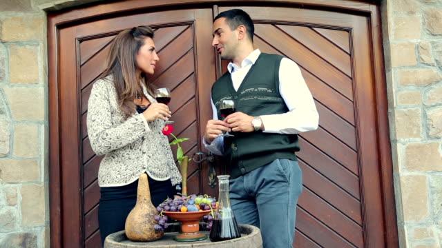 Man and woman tasting wine