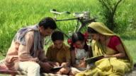 Man and woman teaching their children