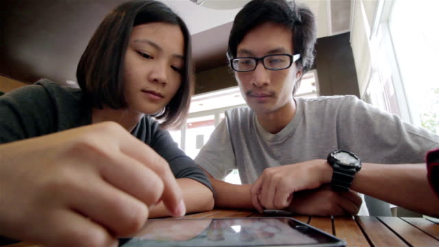 Man and Woman use Tablet in coffee shop