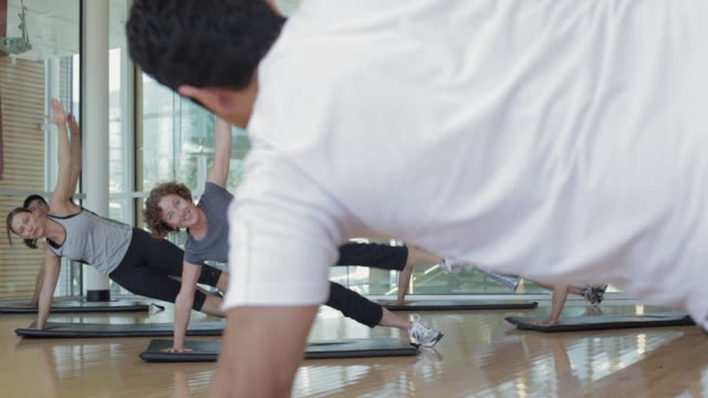 MS DS Man and woman with instructor exercising in gym / Vancouver, British Columbia, Canada