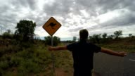 Man arms outstretched in Australia