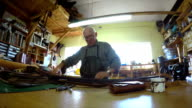 Man arranging workbench