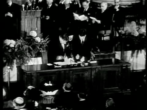 B/W 1949 man at large desk signing NATO pact at United Nations / documentary