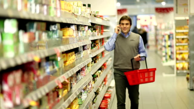 Man at supermarket with cellphone