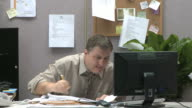 man at work overwhelmed with workload