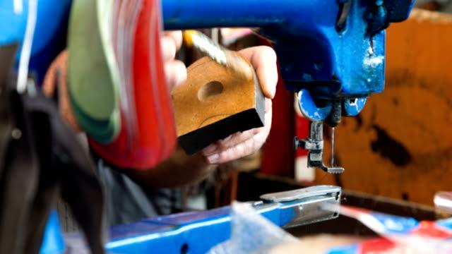 Man At Work Repairing Shoe
