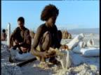 Man bags up freshly mined salt