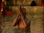 Man bathes and prays in River Ganges