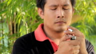 Man breaks a cigarette.