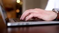 Man browsing internet using his laptop
