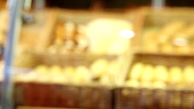 Man buying a bread.