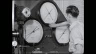 MS Man calibrating measuring instrument / United States