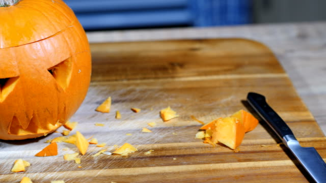 Man carve a pumpkin for halloween party