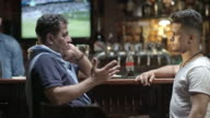 Man chatting with father in pub