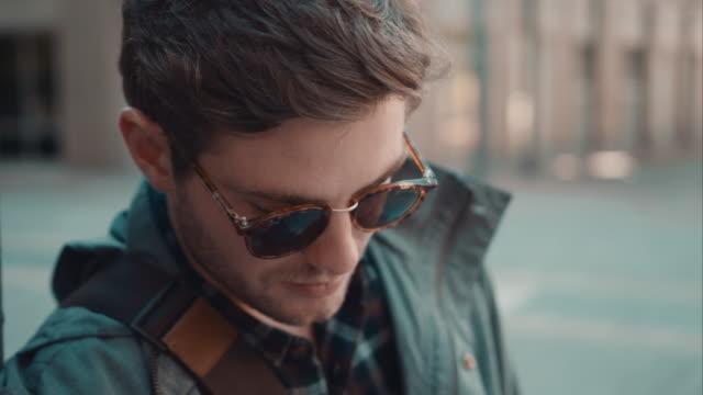 Man checking phone in urban setting