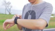Man checking pulse and set the timer before jogging