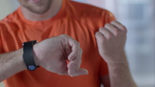 Man cheking his smartwatch
