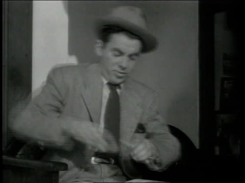 1942 MONTAGE Man chews on candy as a substitute for smoking cigarettes to help quit