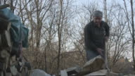 Man chopping wood slow motion