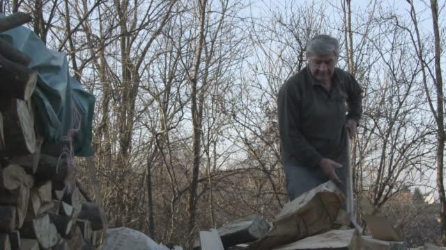 Man chopping wood slow motion
