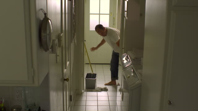 Ws Man Cleaning Tile Floor In Laundry Room Hollywood California Usa ...
