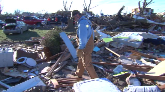 Man Cleaning Up Rubble After Tornado on November 18 2013 in Washington Illinois