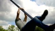 Man climbing a cable