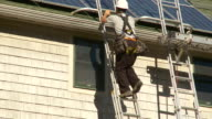 WS TU Man climbing ladder and switching to another ladder / Greenfield, Massachusetts, USA