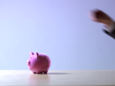 A man collecting coins from a piggy bank Sweden.
