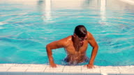 Man coming out of the swimming pool