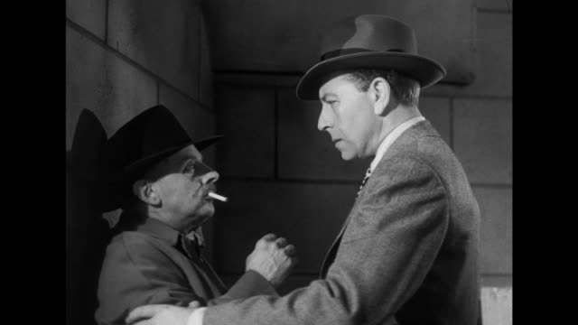 Man (Paul Henreid) confronts man following him only to discover he has a body double