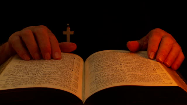 Man consults bible.