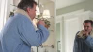 MS Man coughing standing in bathroom, Phoenix, Arizona, USA