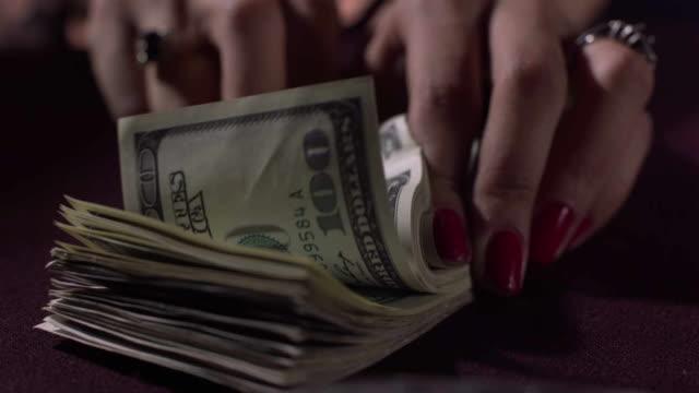 Man counting dollars