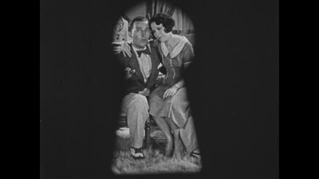 Bing Crosby croons to his lady while they are watched through a keyhole