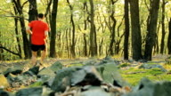Man cross country running in summer forest, 7 clips