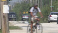 MS Man crossing road on bycical   / Florida Keys, Florida, USA