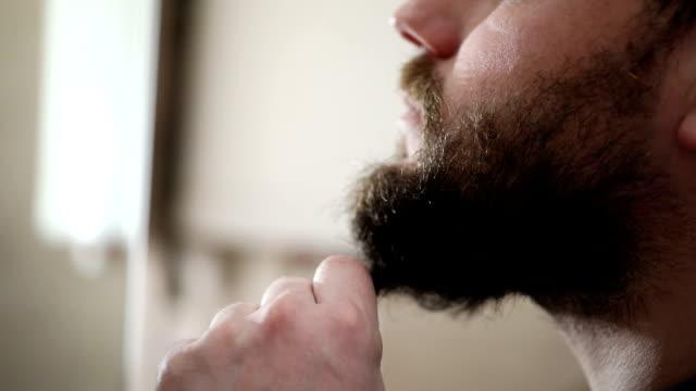 Man cutting his beard