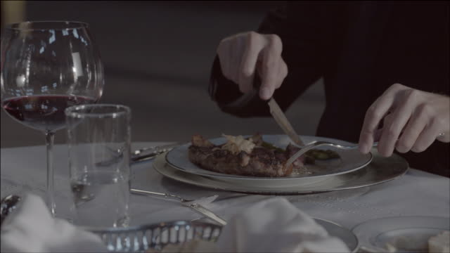 CU Man cutting into steak / Los Angeles, California, United States