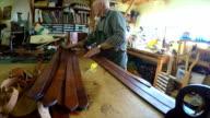 Man cutting leather belts