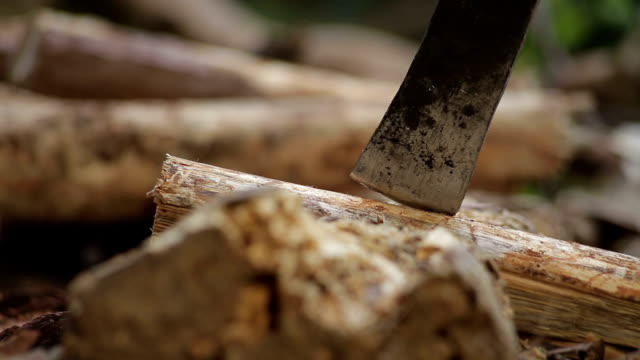 Man cutting wood with hatchet