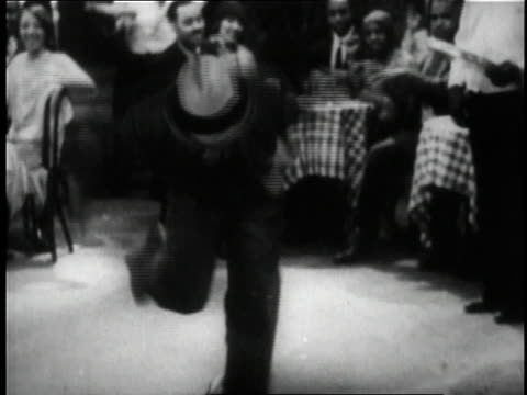 1929 MONTAGE man dancing at a club in the short film St. Louis Blues / New York City, New York, United States