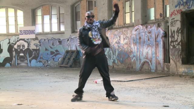 MS ZO man dancing in warehouse, Gent, Belgium