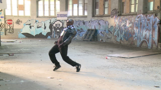 MS man dancing in warehouse, Gent, Belgium