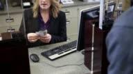 Man depositing cash in bank