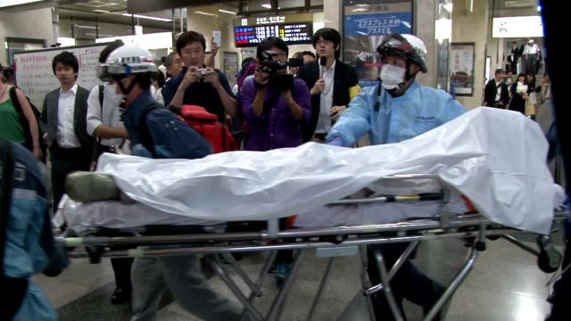 A man died after setting himself on fire on a shinkansen bullet train Tuesday and a female passenger in her 50s also died in the fire which forced...