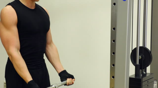 Man doing body building exercise at gym